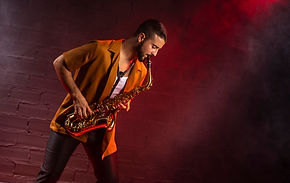 musician-playing-saxophone-fog-with-copy-space_23-2148730901.jpg