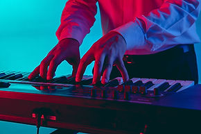 young-caucasian-musician-keyboardist-playing-gradient-space-neon-light-concept-music-hobby