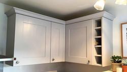 Kitchen wall units: cornice/ winerack fitted.