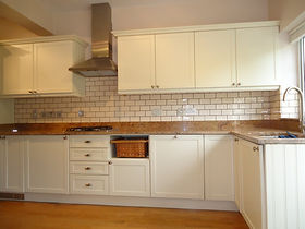 Brick style white tilling with black grout.