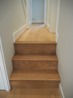 Staircase installed, hardwood stair cladding, hardwood treads and risers