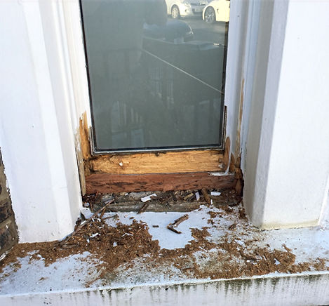 Badly rotten sash window, all wet rot removed ready to be repaired.