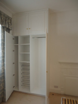 Wardrobe fitted, made to match existing wardrobes, MDF white painted finish.