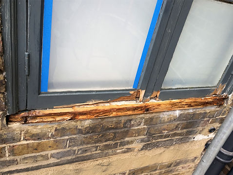 Rotten window, wet rot removed ready for repair.