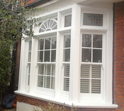 Rotten bay windows restored and painted white.