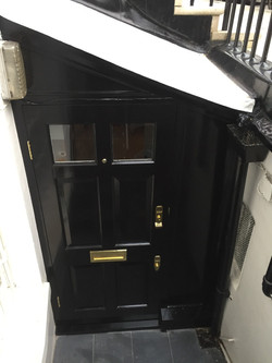 New door front fitted and painted black.