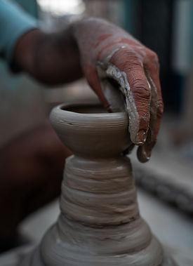 person-molding-a-clay-pot-3145866.jpg