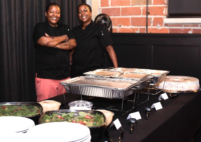 Event caterers, NEON client Chef K (left) and Mariam Omari (right) of K's Revolutionary Catering.