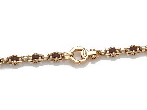 Bracciale in oro rosa 18kt. e anelli di caucciù hi-tech.