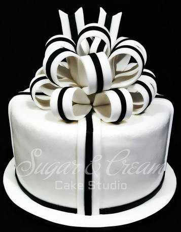 BLACK AND WHITE WITH BOW