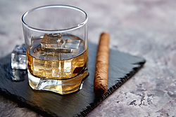 glass-of-whiskey-with-ice-cubes-and-ciga