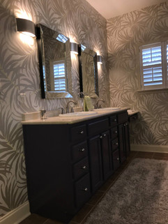 Bathroom Renovation Featuring Wallpaper and Custom Painted Purple Vanity