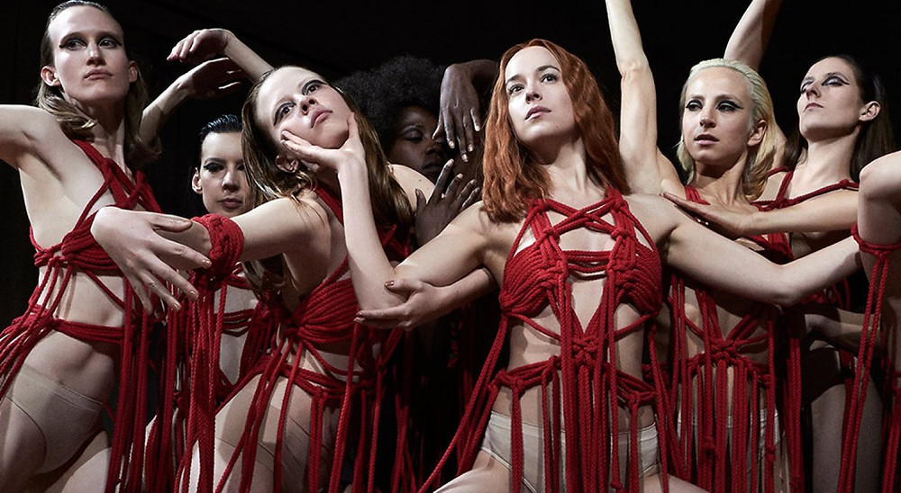 Dakota Jonhson, Mia Goth and the cast of the Tanz Dance Academy, in the sinister performance, Volk