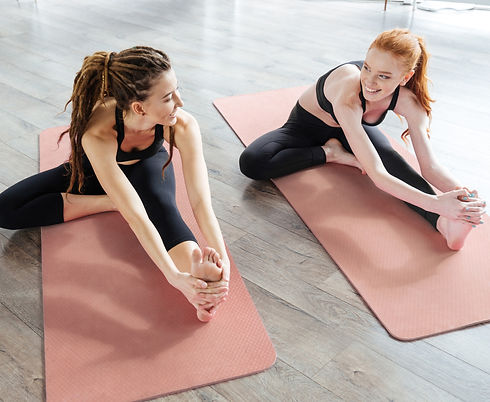 Women%20Stretching%20on%20Yoga%20Mat_edited.jpg