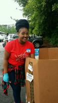Volunteers distribute veggies
