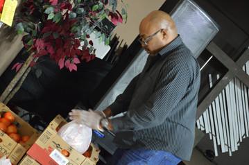 Volunteer prepares veggies for distribution