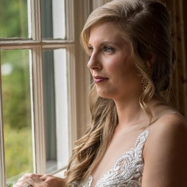 bride peering out window