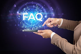 Close-up of a touchscreen with FAQ abbre