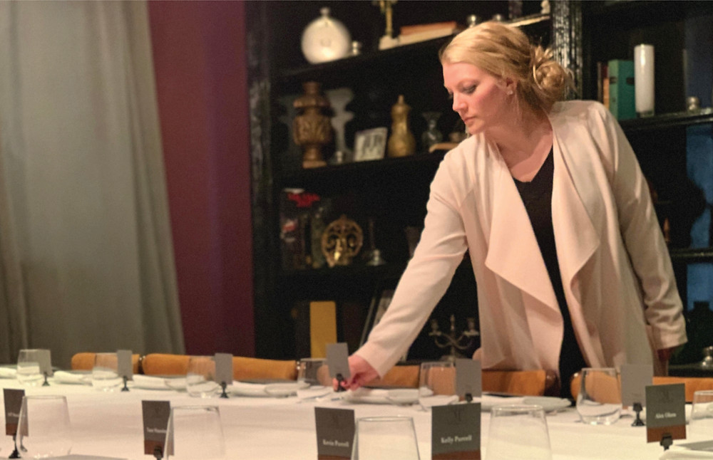 Luxe Life event planner placing table setting