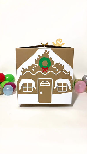 burst of joy gingerbread housr balloon gift box with hot cocoa bombs by luxe life event design
