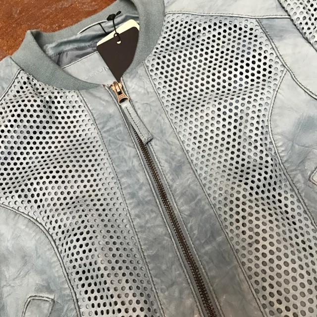 Blue laser cut front zip leather jacket, closeup.jpg