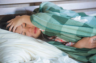 young sick sweet Asian American woman in