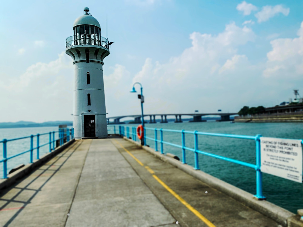 The lighthouse at Raffles Marina overlooking the Tuas link.