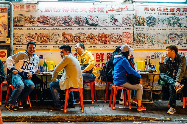 """Diners at an open-air food stall in Hong Kong. This kind of stalls are called """"dai bai dong""""."""