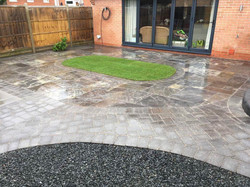 WBC Elite Tumbled Sandstone Paving in Twilight with charcoal alpha edging setts