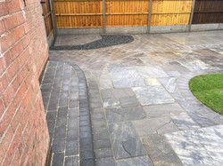 WBC Elite Tumbled Sandstone Paving in Twilight with charcoal alpha edging setts 4