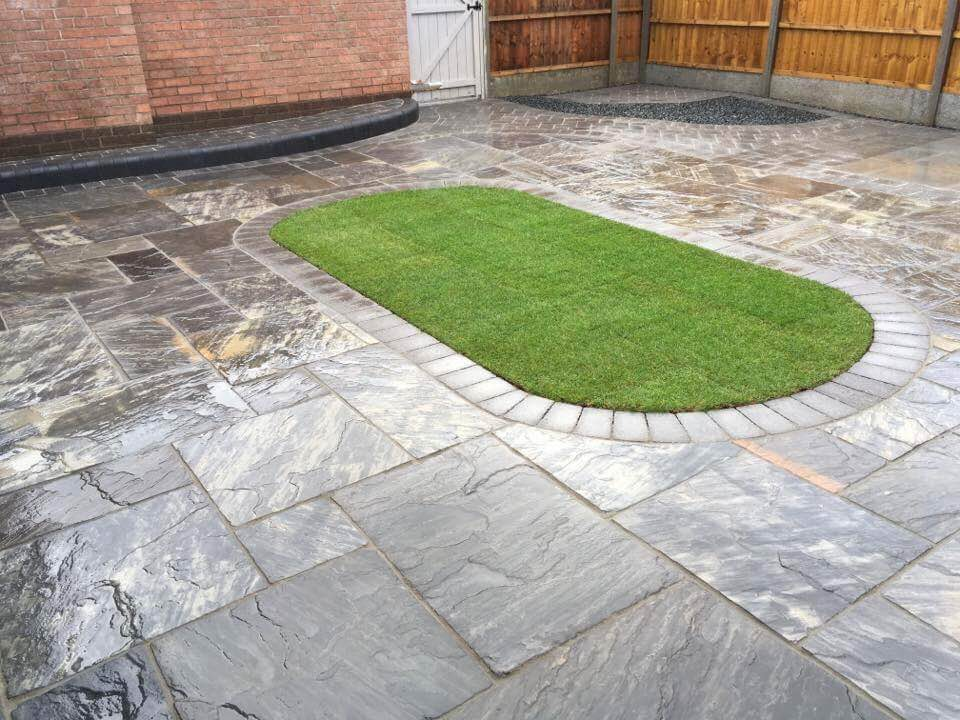 WBC Elite Tumbled Sandstone Paving in Twilight with charcoal alpha edging setts 3