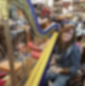 customer trying a used harp.jpg