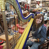 customer trying a used harp.jpg
