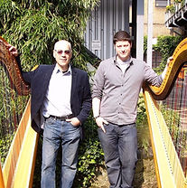owners standing with restored harps .jpg
