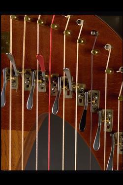 Lever harp levers