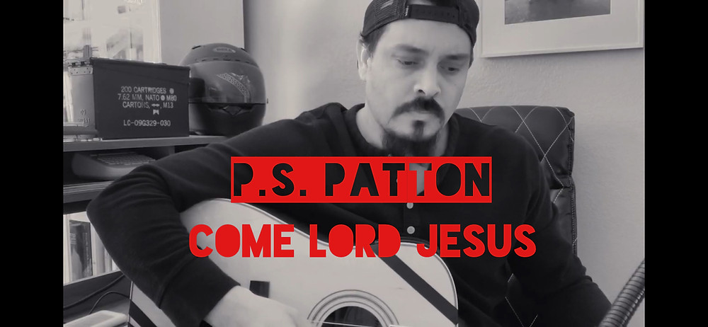 P.S. Patton playing acoustic guitar.