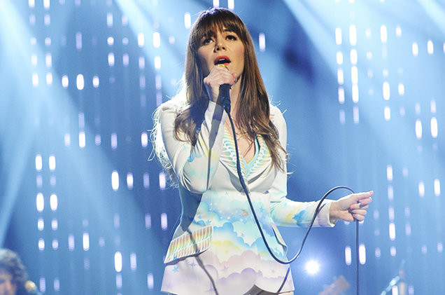 Jenny Lewis performs live in a multi-colored cloud print blazer.