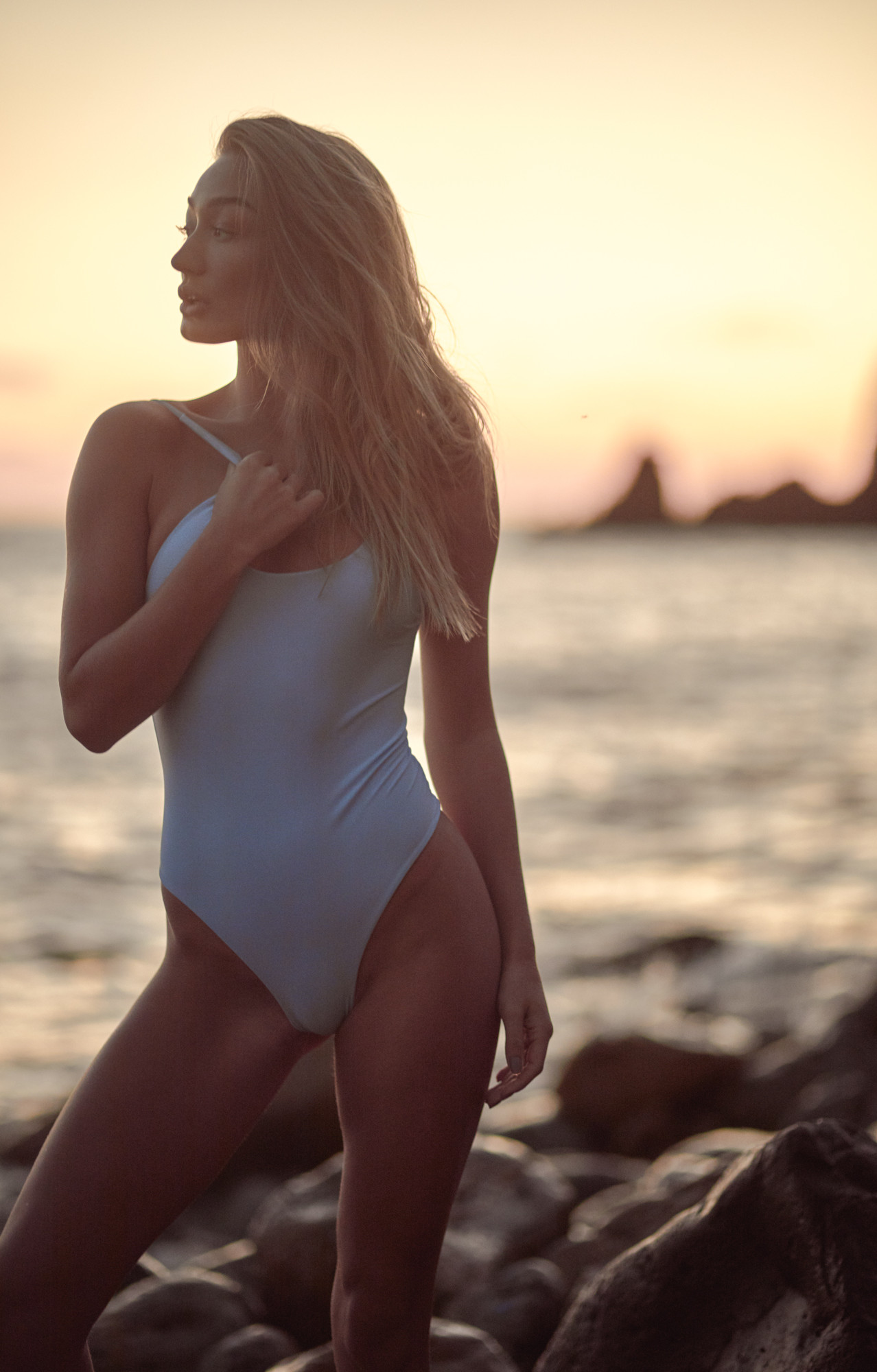 Patrick Patton photography photographs model Bethan Sowerby in a powder blue one piece swimsuit by Kulani Kinis in Malibu