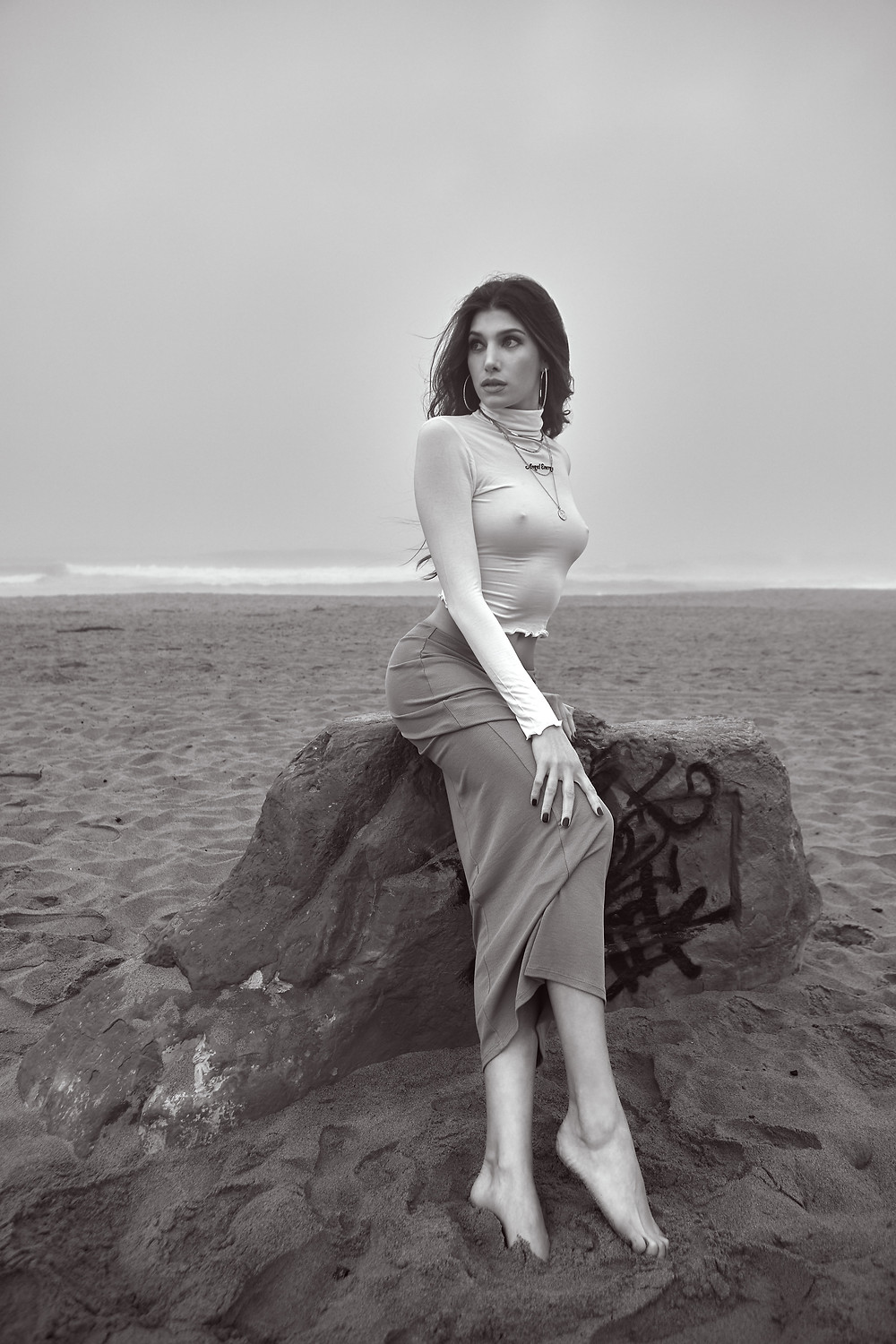 Fashion and swimwear model Sofija Stojkovic wearing a sheer white top and a long maxi skirt.  This image may be deemed sexual and NSFW as nipples and titties are clearly visible.