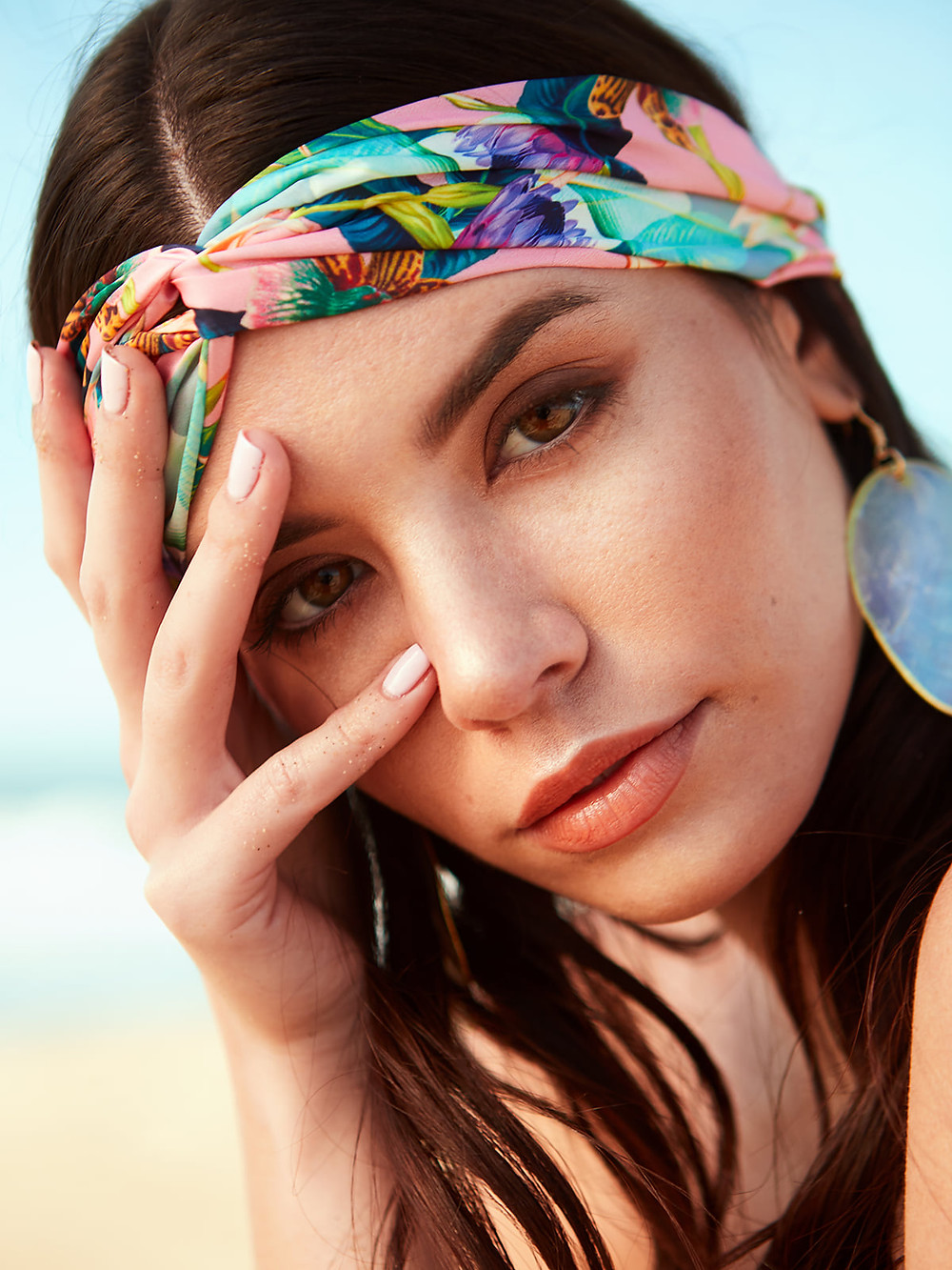 A tight fashion portrait of model Gracie Phillips wearing a multicolor headband and abalone earrings from H&M.  Photographed by Patrick Patton.