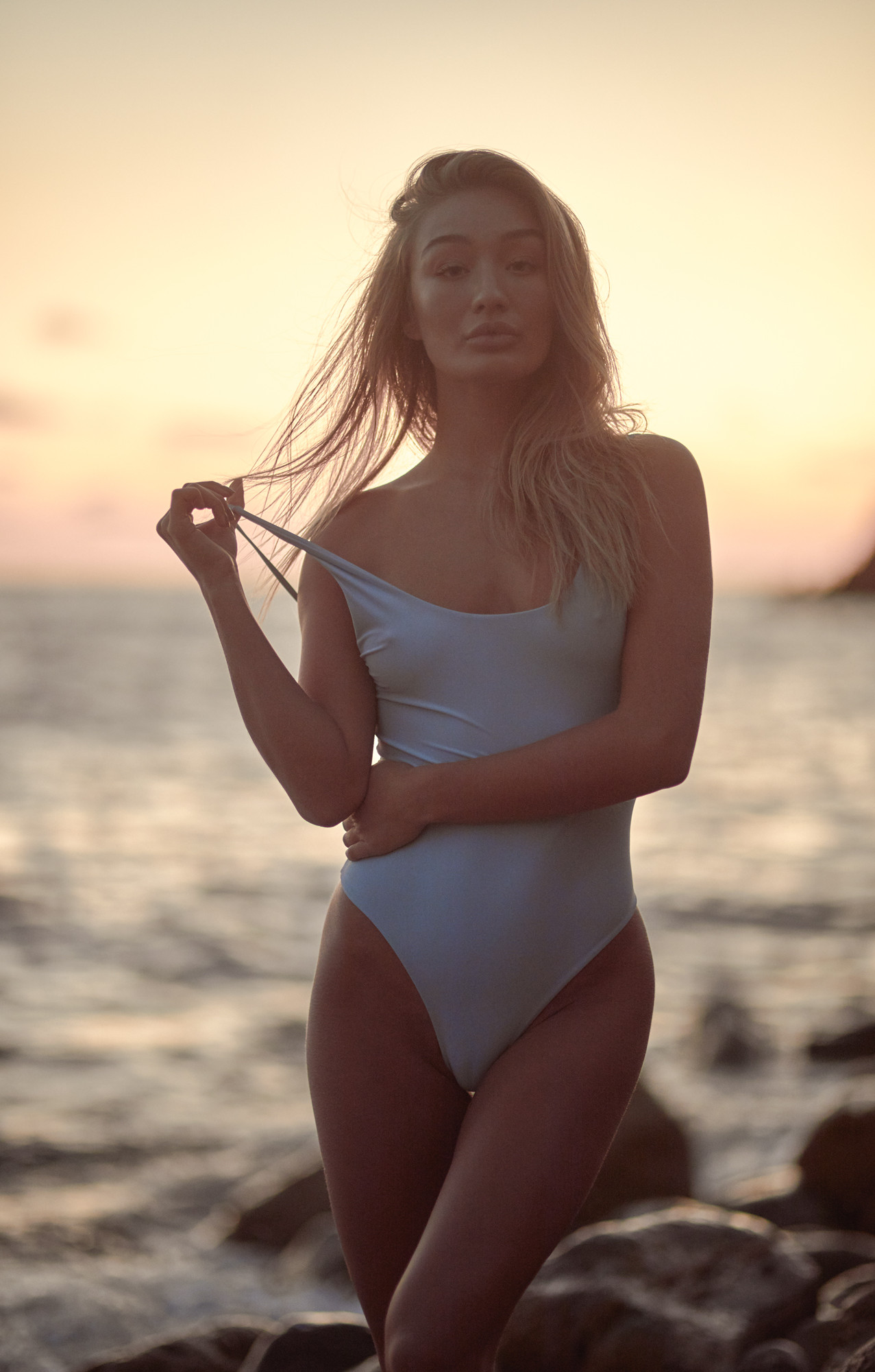 Patrick Patton photography photographs model Bethan Sowerby in a powder blue one piece swimsuit by Kulani Kinis at sunset