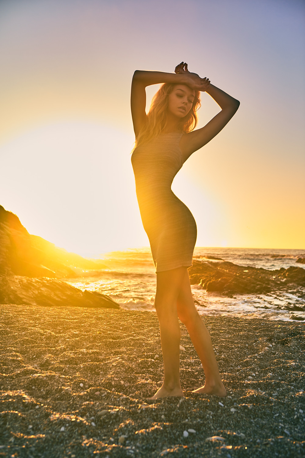 Model Julia Greenhalgh on the beach at sunset wearing a sheer and sexy dress by Amuse Society with photography by Patrick Patton