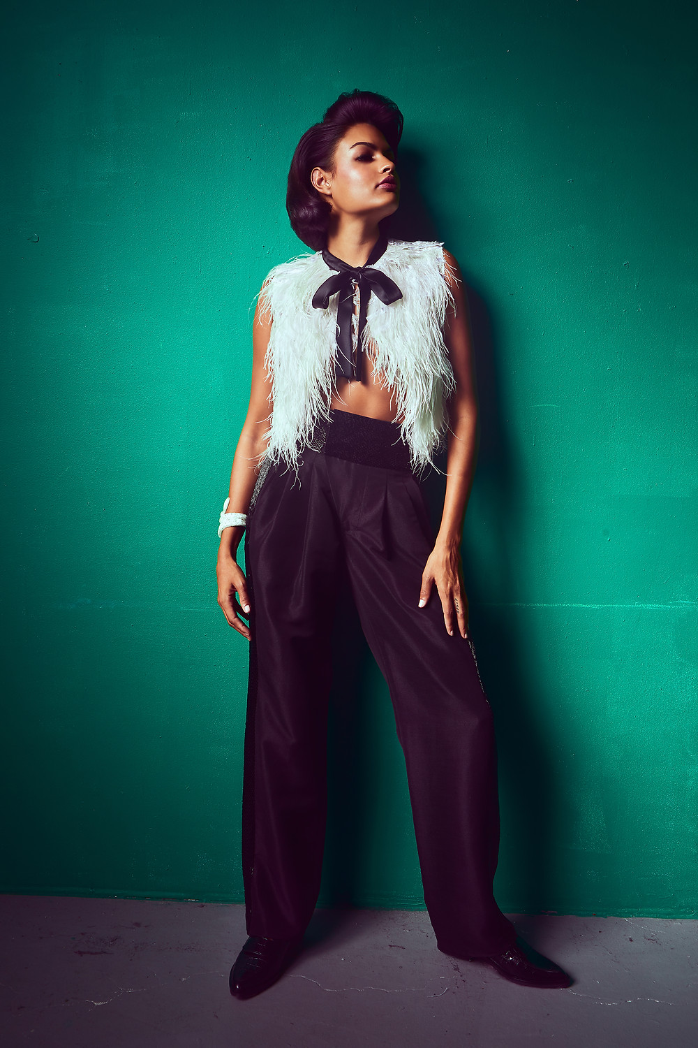 Fashion model Sianna Nelson for Elegant Magazine by Patrick Patton, wearing: Cream feather top w black bow – Farah Al Mesbah @farahalmesbahofficial Black beaded trousers – Rajo Laurel @houseoflaurel Black Loafers –Rebecca Minkof