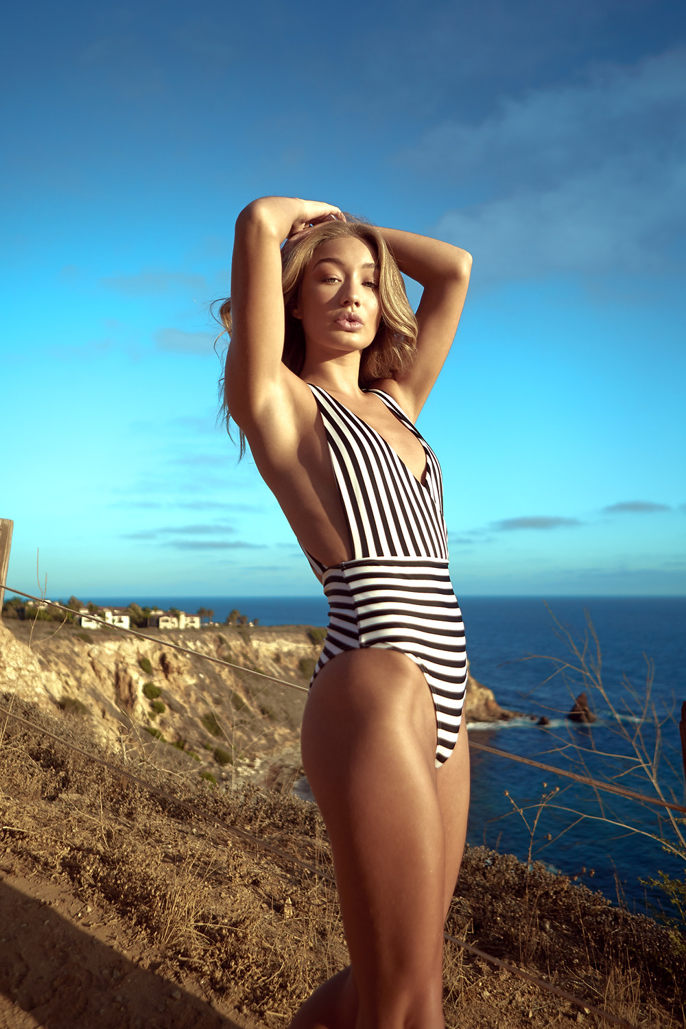 Manchester Model Bethan Sowerby models a black and white striped one-piece swimsuit from ASOS.