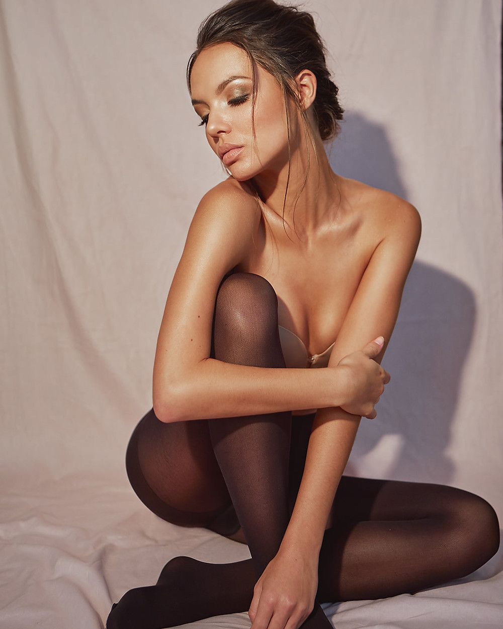 The Beautiful Bianca Vierra looks like Emily Ratajkowski with pink lips and wearing a nude strapless bra and black tights for a beauty photoshoot with Patrick Patton Photography.