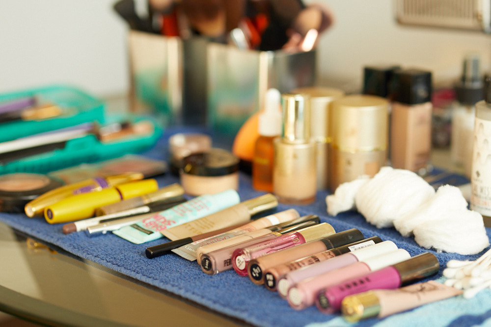 Behind the scenes - makeup is laid out on the table.