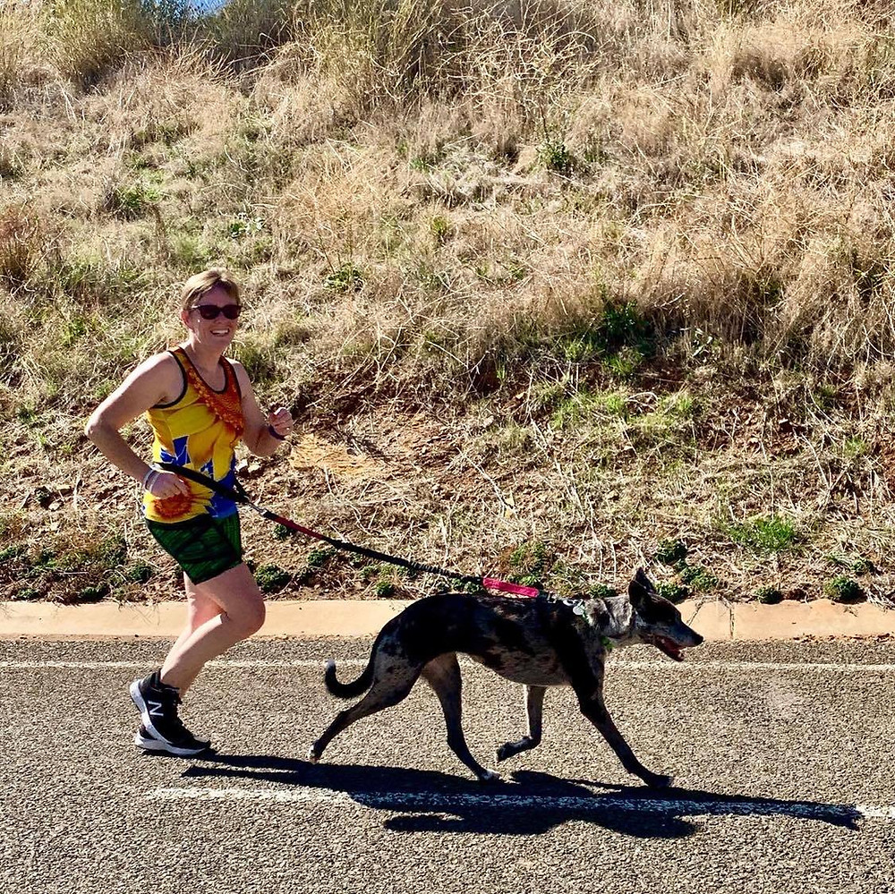 Louise running comfortably with her dog 'Anna'