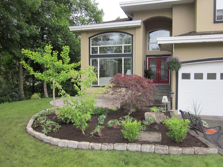 Entrance way Planting with Natural Stone Edging