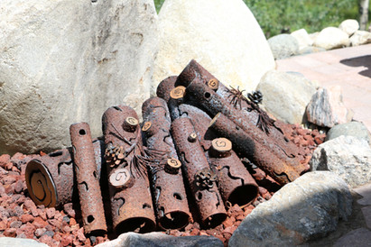 COLLAPSED IRON LOG STACK