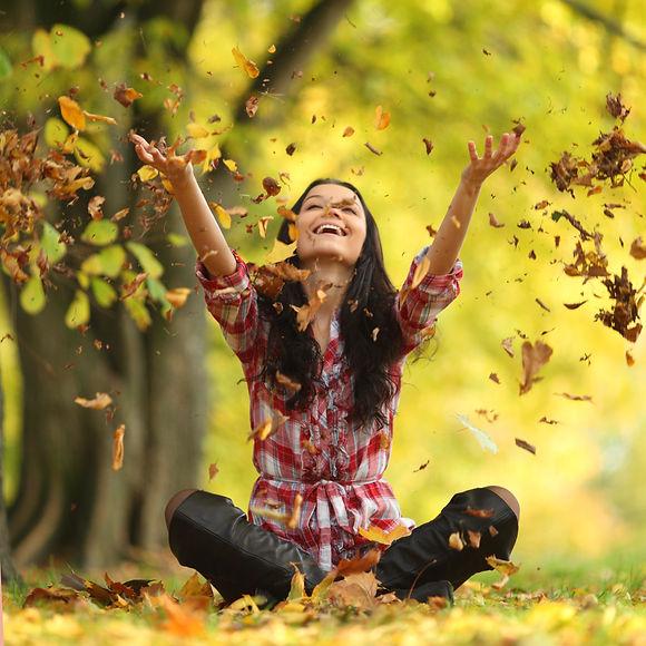 Lady throwing leaves.jpg